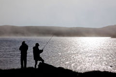 Fishing. In lake a misty day Royalty Free Stock Photography
