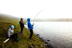 Fishing. In lake a misty day Stock Photography