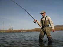 Fishing. Fisherman in wild river Stock Photo