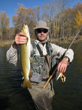 Fishing. Fisherman catched big fish Royalty Free Stock Photo