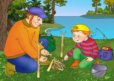 Fishing. Father and son bonfire on the shore of the lake Stock Photos