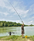 Fishing. Woman is fishing on the lake Royalty Free Stock Images