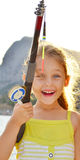 Fishing. Smiling little girl on a fishing trip Royalty Free Stock Photos