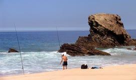 Fishing. Man fishing in a sunny beach Stock Photo