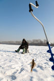 On fishing. The fisherman on winter fishing in frosty day Stock Images