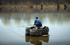 Fishing. Men were fishing at a small river in early spring, northeast China Stock Photos