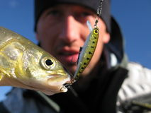 Fishing. Fisherman catched trout in Mongolia Royalty Free Stock Image