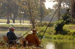 Fishing. Two fishermen Royalty Free Stock Photos