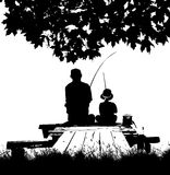 Fishing. Silhouette of father and son fishing Stock Photos