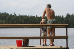 Fishing. Near the lake - father and son stock image