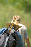 Fishing. Two men walking away from a lake with fishing rods Stock Photos