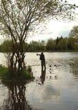 Fishing. Man fishing in a lake for carp Royalty Free Stock Image