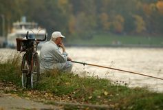 Fishing. The person with a fishing tackle on a coast of the river Royalty Free Stock Photo