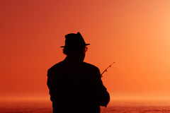 Fishing. A man  for fish in the sunset Stock Image