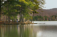 Fishing. Men fishing from the shore Stock Photos