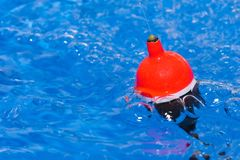 Fishing. Float in clear flowing water royalty free stock photography