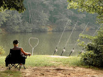 Fishing. In the rain relaxing at the lake Royalty Free Stock Photo