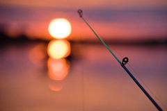 Fishing. Tackle against a rising sun Stock Photography
