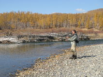Fishing. On river in wildness Stock Photos