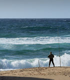 Fishing. Fisherman on the shore in Portugal royalty free stock images