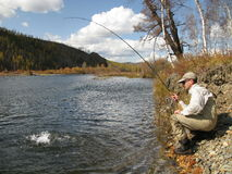 Fishing. In wildness on river Stock Images