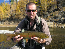 Fishing. Trout catched on river Royalty Free Stock Photos