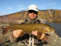 Fishing. Giant trout catched on river Royalty Free Stock Photo
