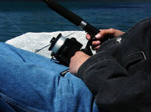 Fishing. Hands holding a fishing pole Stock Images
