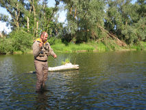 Fishing. Fly fishing in summer river Stock Photos