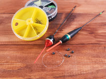 Fishing accessories - sinkers, floats and round boxes. Stock Image