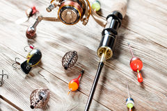 Fishing accessories on a wooden background. Royalty Free Stock Image