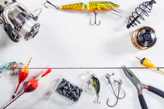 Fishing accessories on a wooden background. Royalty Free Stock Photos