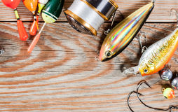 Fishing accessories on a wooden background. Stock Image