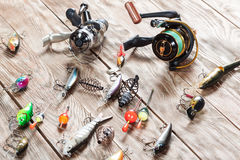 Fishing accessories on a wooden background. Stock Images