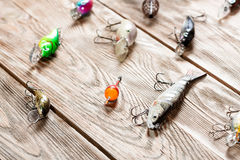 Fishing accessories on a wooden background. Stock Photos