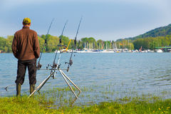 Fishing adventure on a great lake. Fisherman waiting to catch a fish Royalty Free Stock Photography
