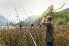Fishing adventures. Angler with a throwing stick for boilies royalty free stock photos