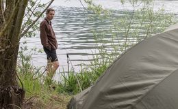 Fishing adventures, carp fishing and camping on lake royalty free stock photo