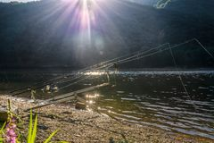 Fishing adventures, carp fishing. Backlit fishing gear bite alarms, rod pod, fishing rod, fishing reel Royalty Free Stock Images