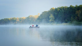 Fishing. Anglers fishing early in the morning on the misty river. Dnipro river. Ukraine. Early autumn Royalty Free Stock Photos