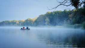 Fishing. Anglers fishing early in the morning on the misty river. Dnipro river. Ukraine. Early autumn Stock Photo