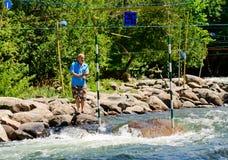 Fishing around a slalom gate Stock Images