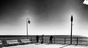 Fishing. Artistic look in black and white. Royalty Free Stock Photos