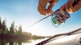Fisherman with spinning on the lake. royalty free stock photos
