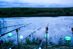 Fishing on bad weather. Rods waiting on stands stock photos