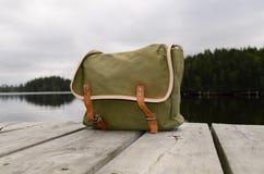 Fishing bag. On the bridge Royalty Free Stock Photo
