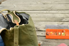 Fishing bag. On the bridge, a box of lures on the side Stock Images