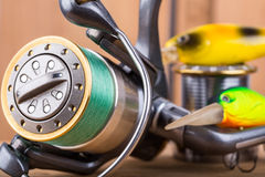 Fishing bait wobbler and reel with line Royalty Free Stock Photo