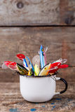Fishing baits wobblers protrude from white metal cup Royalty Free Stock Photos