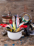 Fishing baits wobblers protrude from white metal cup Stock Image